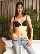 Justine is so hot and lascivious in her black bra and tight jeans.
